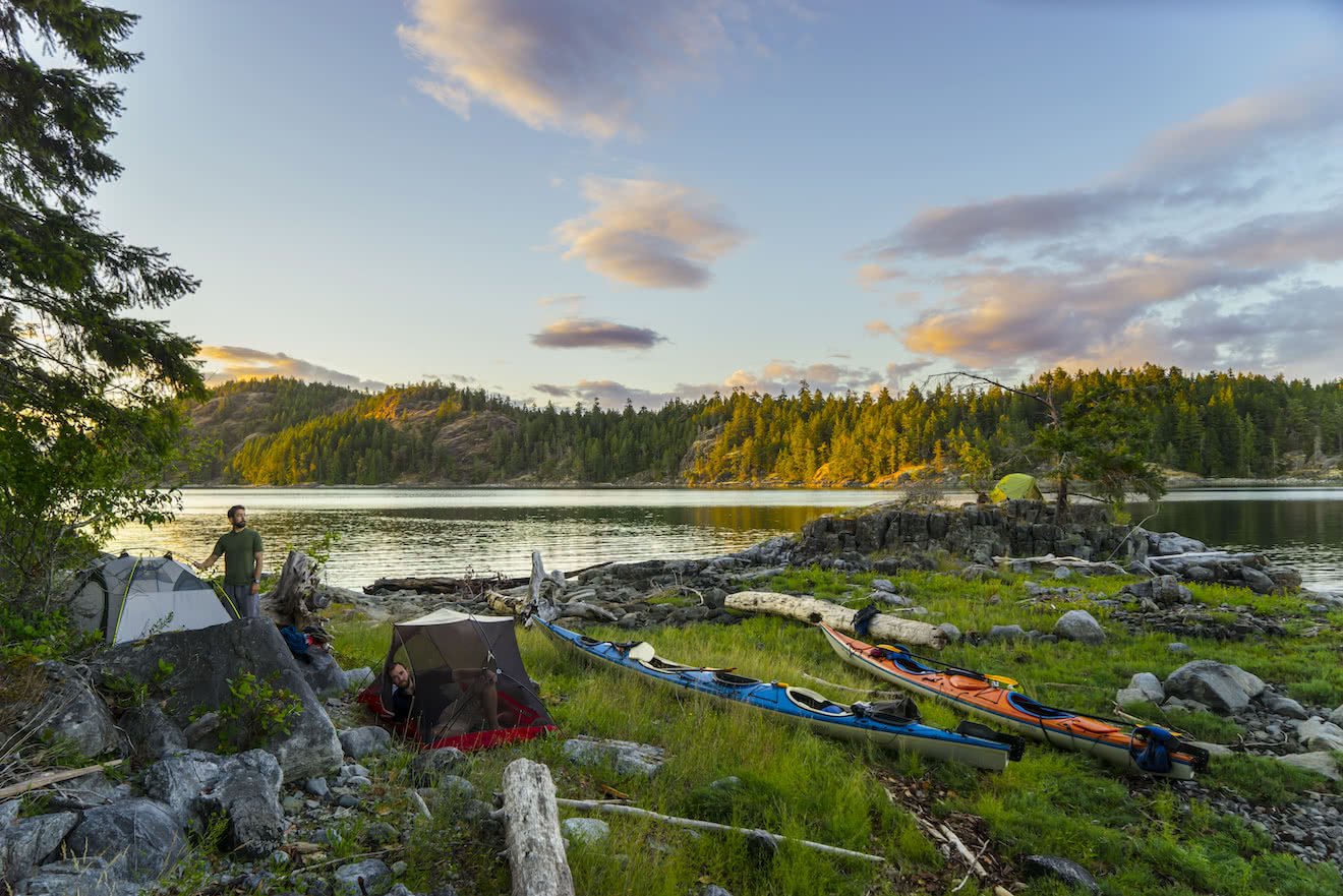 A group of campers on a sea kayak tour in British Columbia