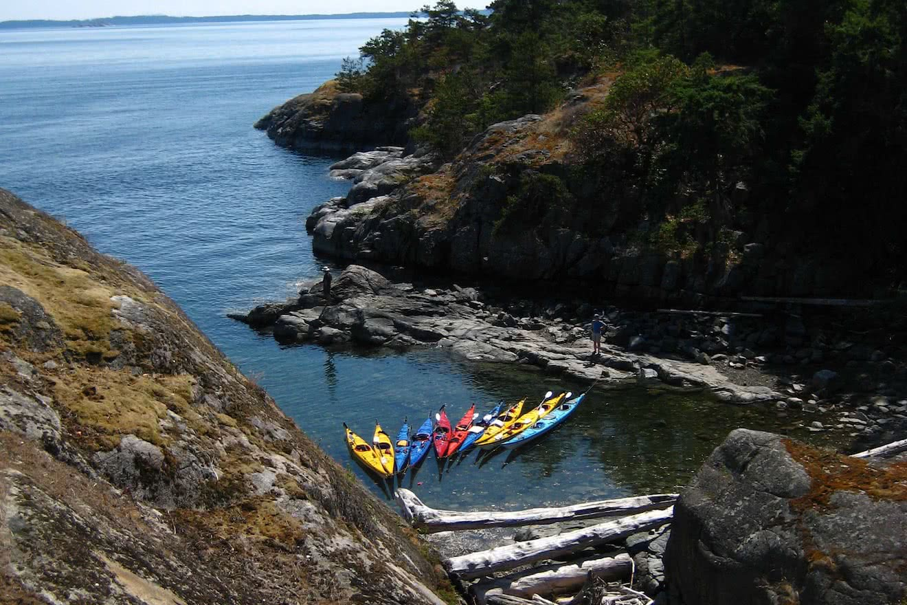 Kayaks tied up at lunch in Copeland Islands in Desolation Sound during one of our Lund kayak tours