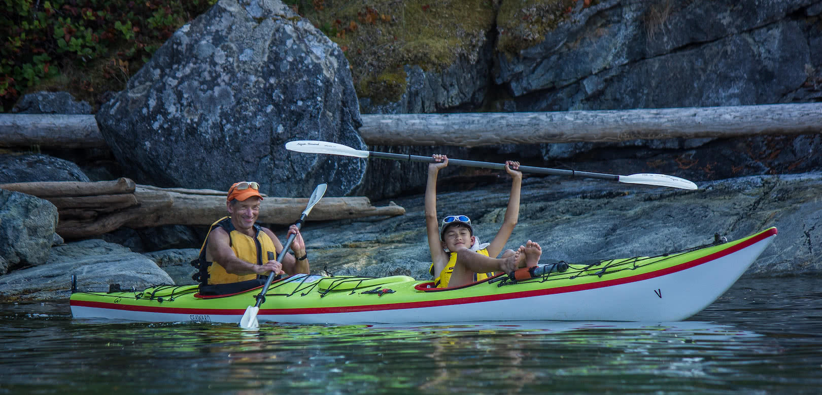 A father and son paddling on one of our multi-day kayak tour