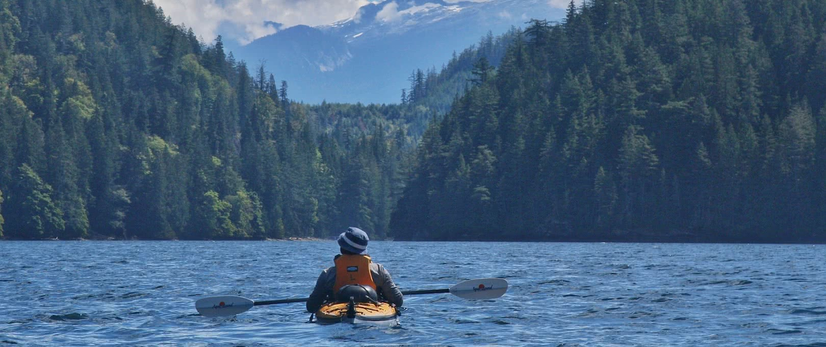 A kayaker sitting and enjoying the view on one of our 7 day sea kayak expeditions in Pryce Channel