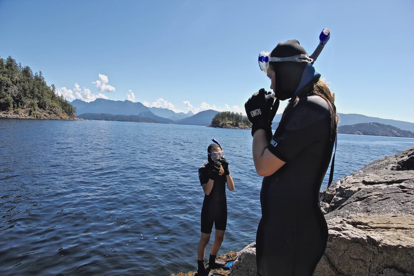 Two young guests get ready to snorkel in Desolation Sound