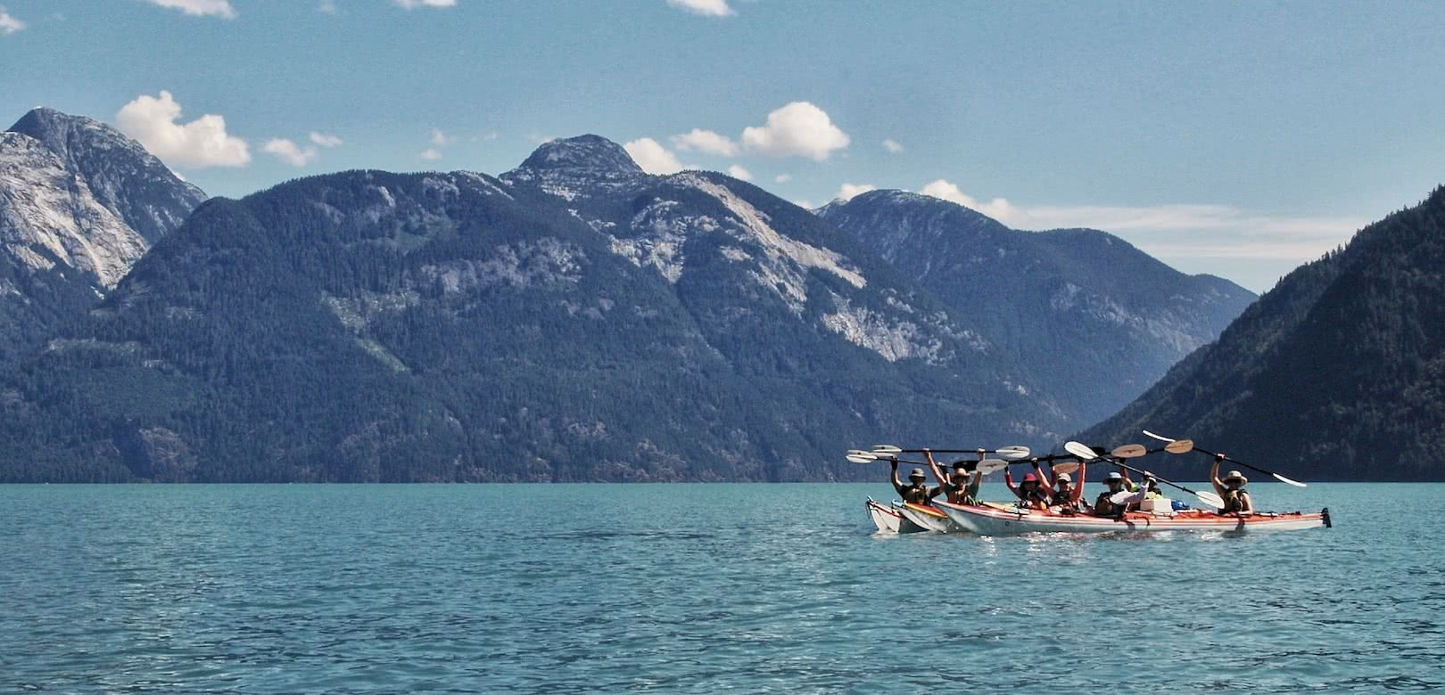 A group of kayakers in Toba Inlet on one of our sea kayak expeditions