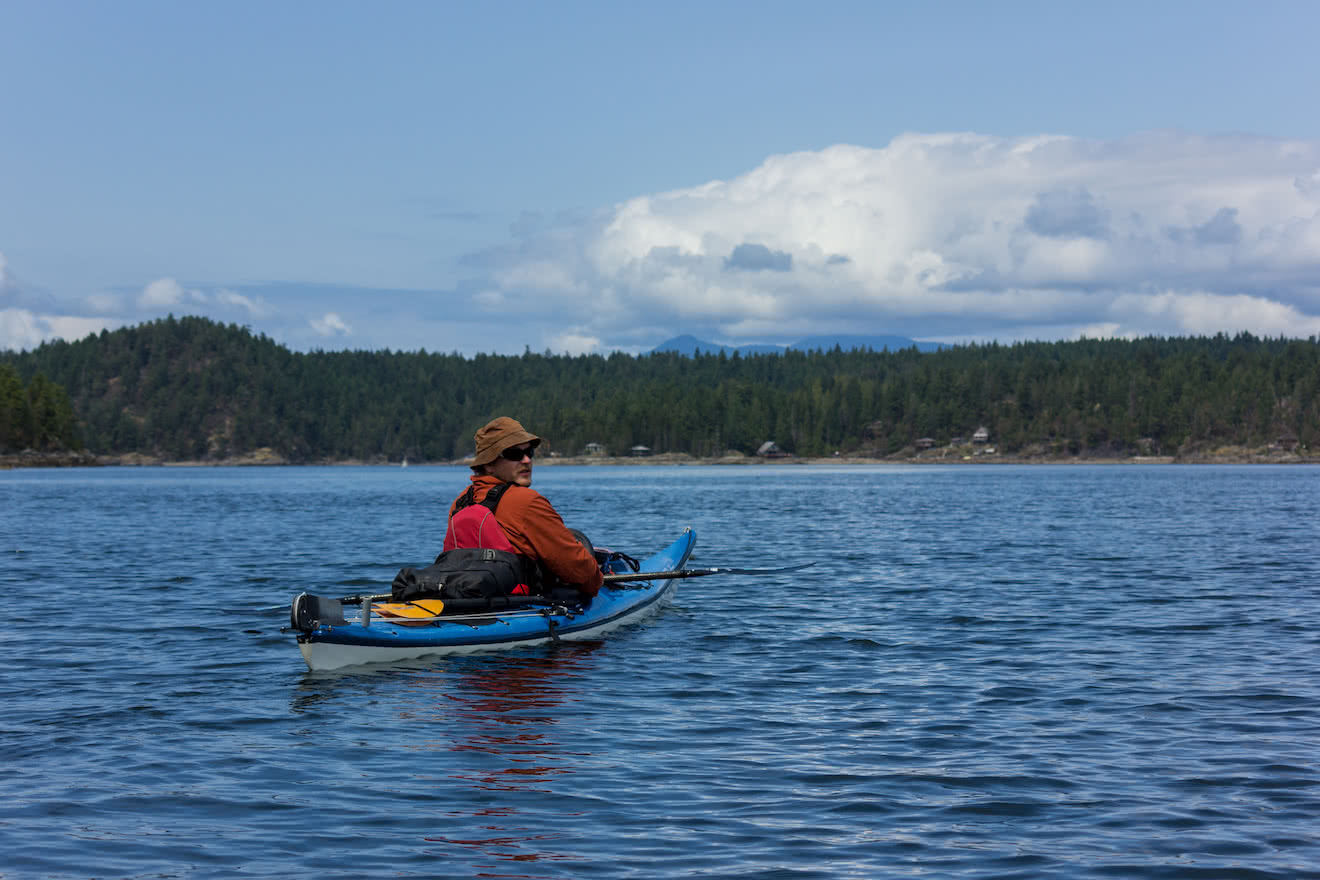 A kayaker in calm Okeover Inlet