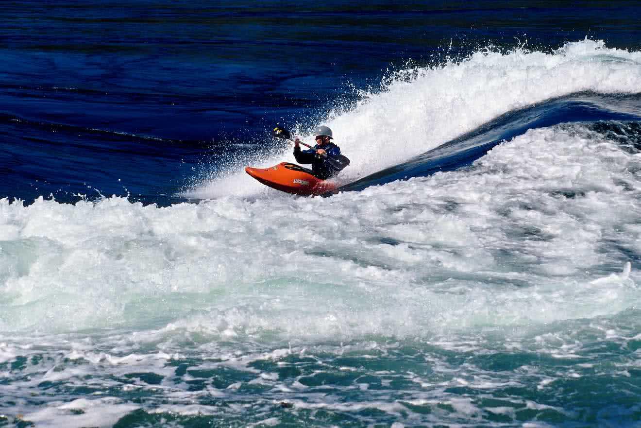 A kayaker surfing the tidal rapids at Skookumchuck on the lower Sunshine Coast