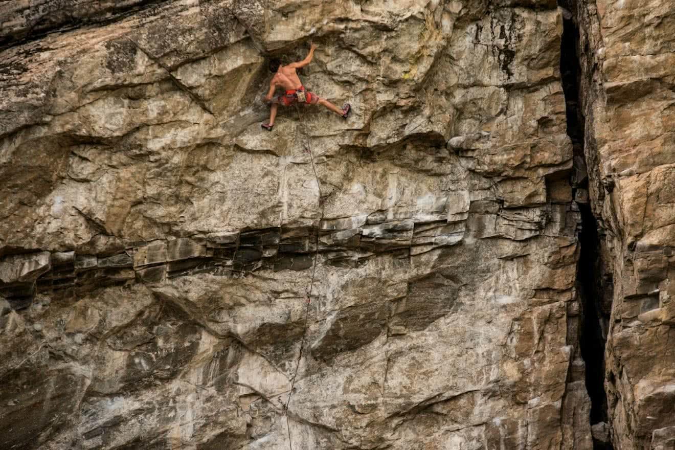 A rock climber high on a wall