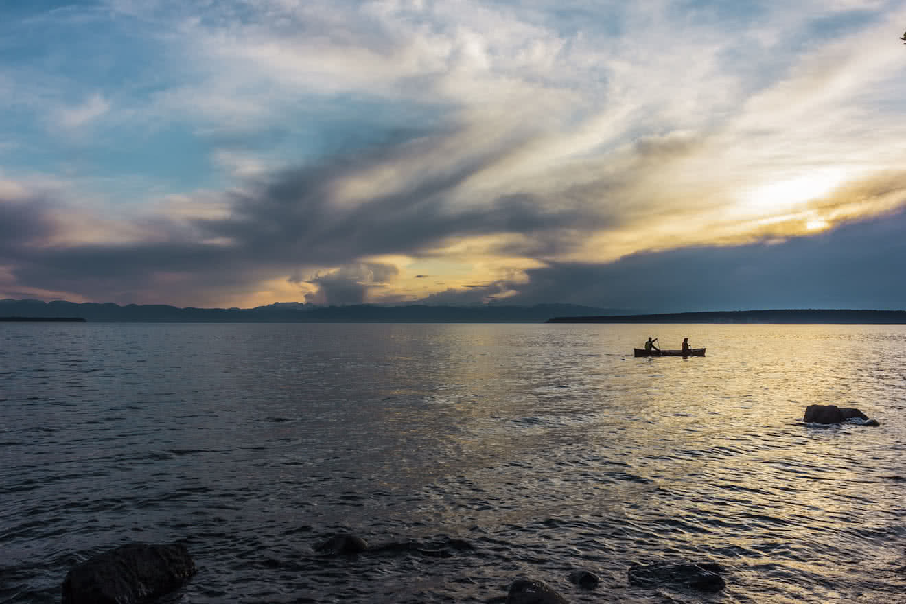 Two canoeists paddling along Powell River beaches
