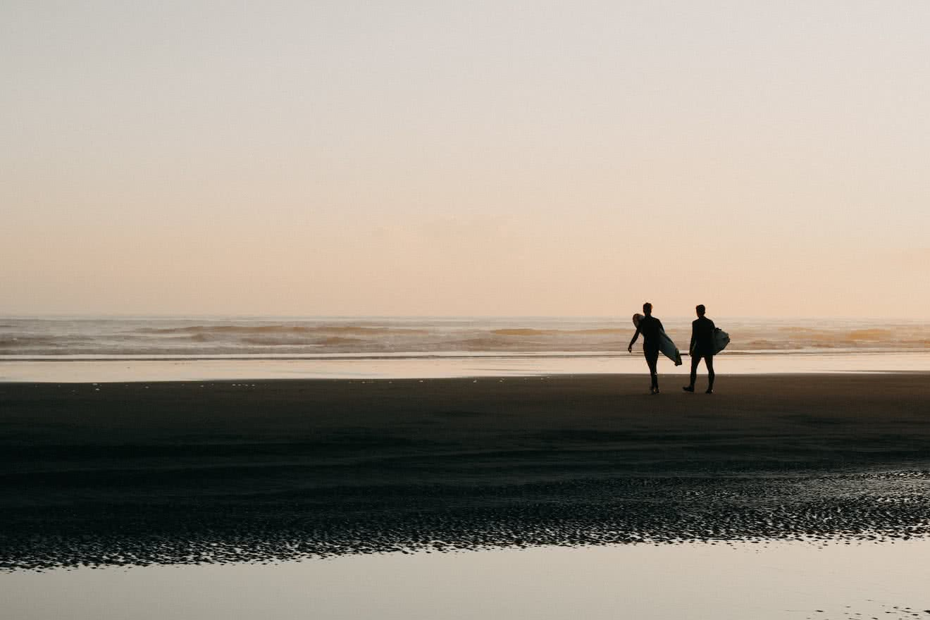 Two surfers in Tofino, British Columbia