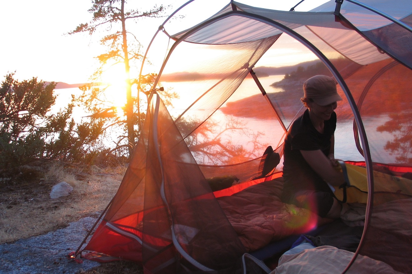A tent with the sunset at the Copeland Islands