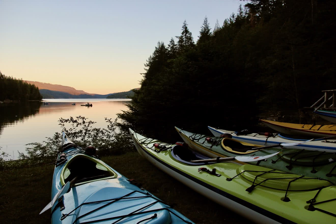 Sea kayaks staged for a day of kayaking in BC s Desolation Sound
