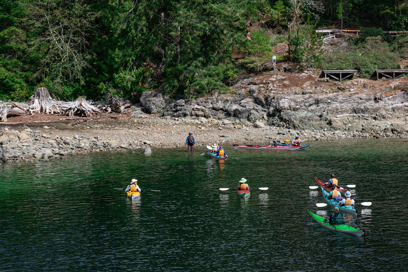 A guided group approaches the campsite at Hare Point