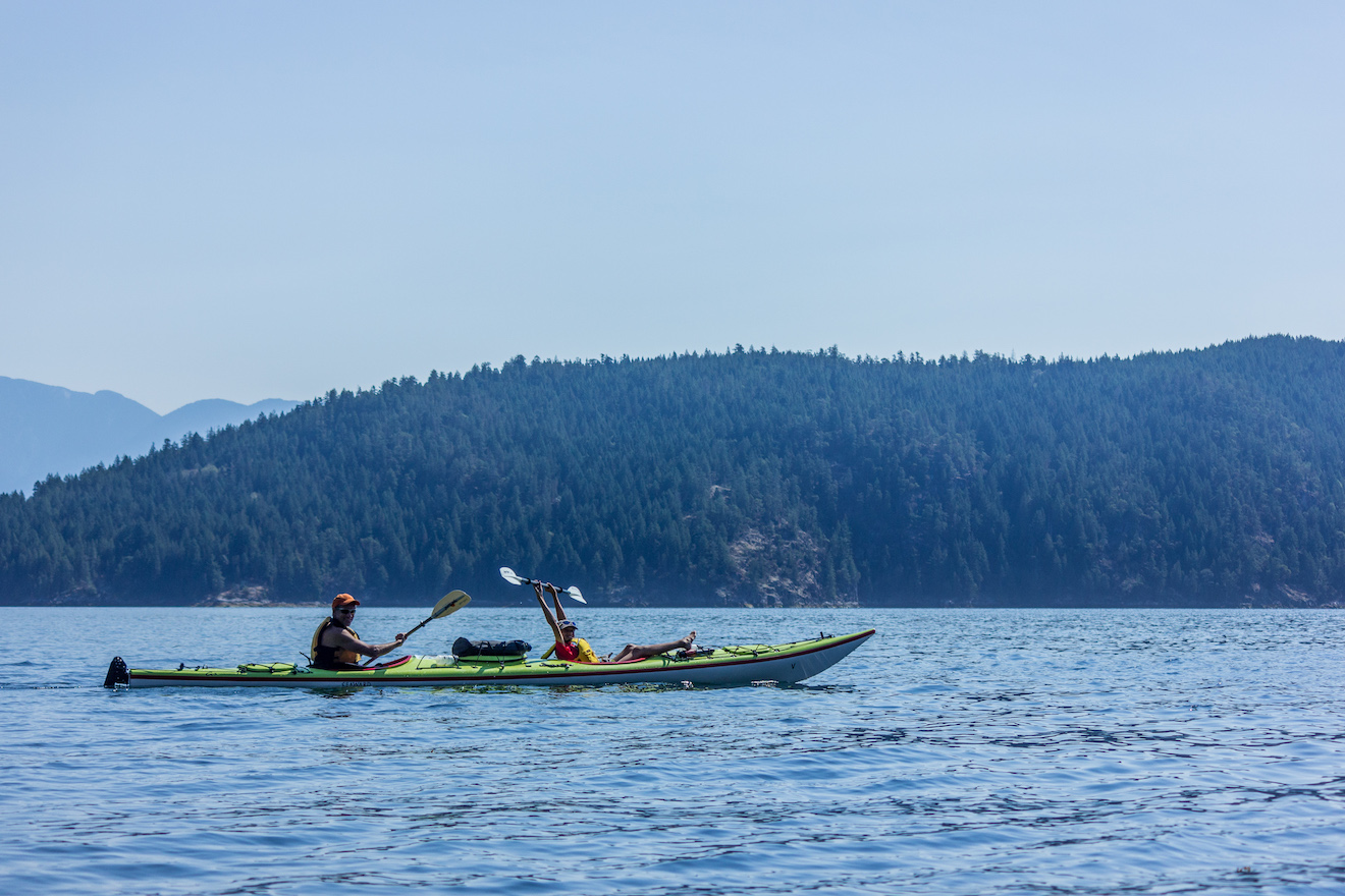 Paddling on a family kayak trip in Desolation Sound